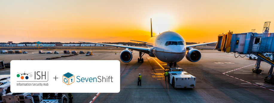 Airplane waiting to be loaded. ISH and Sevenshift logos
